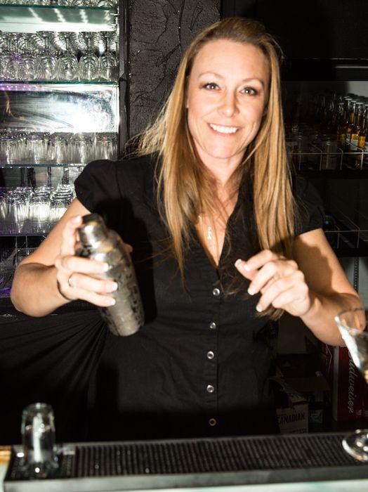Absolute Bartending bartender makes a cocktail.