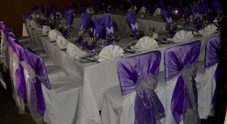 Cadburys Purple Organza Shawls and Platinum Organza Bows on White Chair Covers