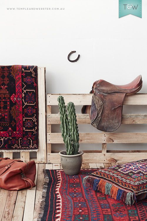 A selection of Afghan Tribal Rugs, Kilims and Floor Cushions