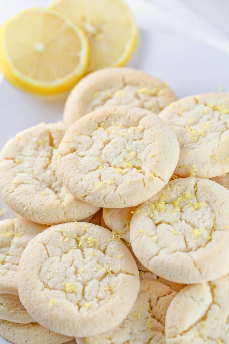 Lemon Sugar Cookies: perfectly soft and chewy, these cookies are made with 100% real lemon - no lemon cake mix or pudding. bake up a delicious batch of summertime, any time of year! {Bunsen Burner Bakery}