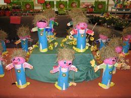 * Vogelverschrikkers gemaakt van een Pringgles bus