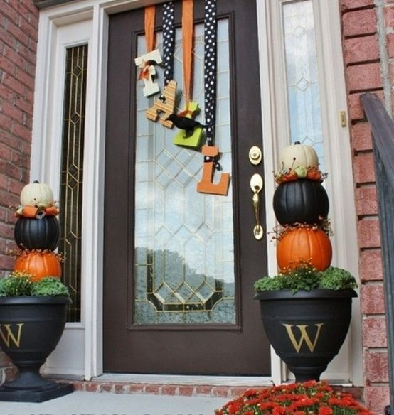 Love the flower pots with the monogram and pumpkins. I could do without the cheezy letters hanging from ribbons (I hate when you shut the door and the decor hits.). Great Idea for Christmas too!