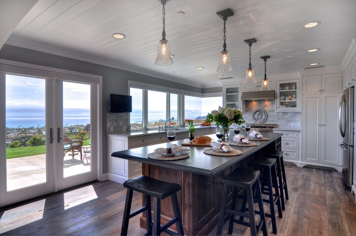 Classic Kitchen: traditional, classic, beach architecture, beach style, beach organic, stained wood Island, painted wood ceiling, painted crown molding, Ornamentation, Trim, paint & stained cabinets, painted raised  panel cabinet doors, glass panel cabinet doors, open shelves, farm sink, steel oven hood, recessed can lights, pendant lights, French doors, natural wood floors.
