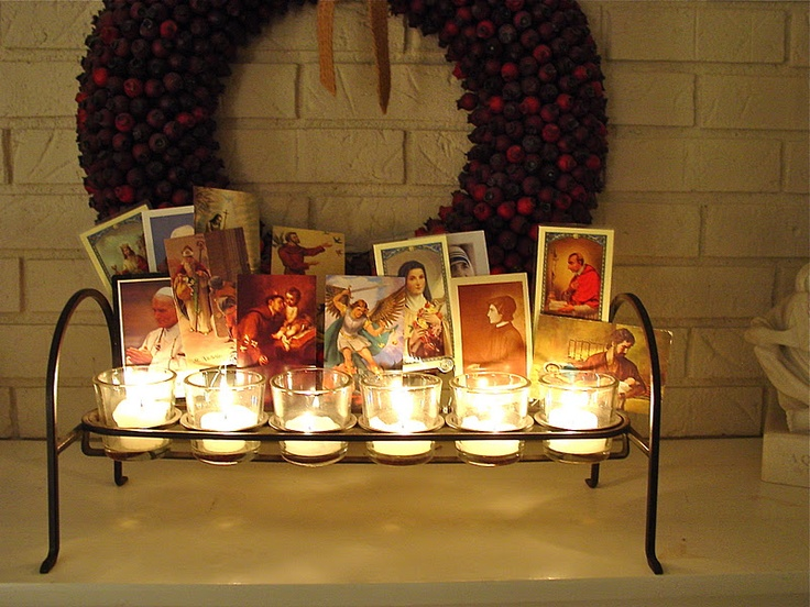 Great idea for All Saints' Day! Display prayer cards with candles.