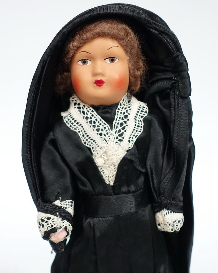 Maltese doll wearing the ghonnella (also known as faldetta), the typical hooded cloak