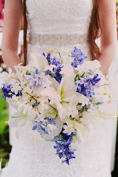 Soft white lilies & blue delphinium bouquet.  (Design by Lee Forrest Design, photo by Emily Gilbert Photography)