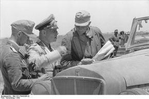 Generalfeldmarschall Erwin Rommel speacking with officers. North Africa  1942