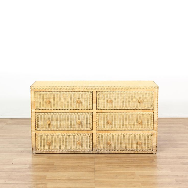 This long dresser is featured in a woven wicker with a light pecan finish. This coastal style chest of drawers has 6 spacious drawers, simple straight sides, and braided accents. Perfect for storing clothing! #coastal #dressers #longdresser #sandiegovintage #vintagefurniture