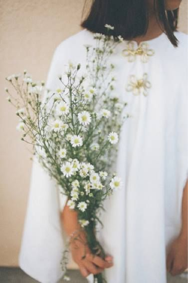 Dressed my flower girls in capes, carrying a bouquet of daisies. #flowergirl #weddinginspiration #flowergirldresses #flowergirlideas #weddingideas #bouquet #daisies #cape