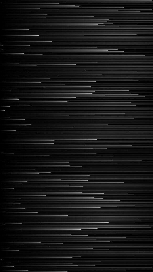 Um Wallpaper de feixes de luz correndo.