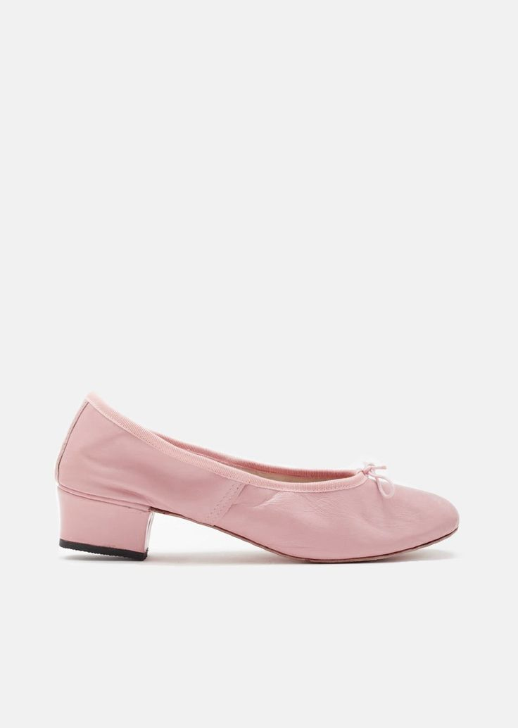 slip-on ballet heels in soft full-grain leather handmade in Italy, with tonal ribbon ties and grosgrain trim. Grosgrain drawstring funnel with cord tie. $250
