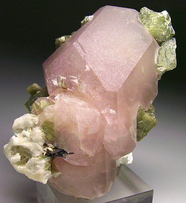 Example of uncut morganite crystal, a pink gemstone version of beryl. This specimen came from a mine outside of San Diego, CA.