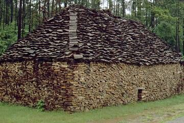 Woodpile in shape of cottage