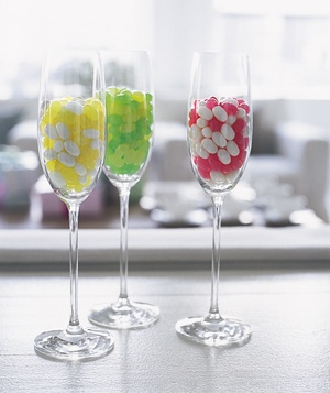 Garnish a baby-shower table with Champagne glasses, each filled with a perfect coupling of jelly-bean flavors (coconut with pineapple, lemon with lime, and cherry with vanilla).