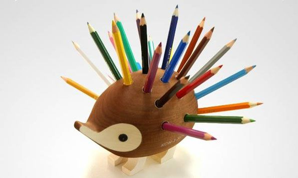 Here's a super adorable hedgehog pencil holder. The pencils are its little spikes. Dawww! You can have your very own for just $65 which includes free shipp