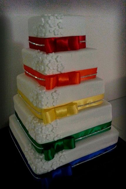 Layered cake, with multi-coloured ribbon