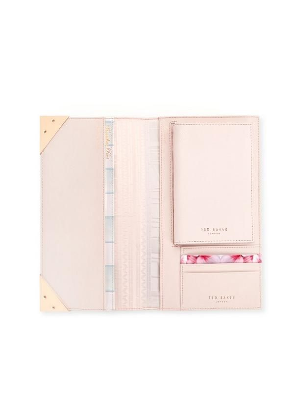 Ted Baker Travel Wallet - Baby Pink This travel wallet by Ted Baker holds all your have-to-hand essentials that you need for your next well-earned holiday! Its sleek silhouette sits in your suitcase without taking up too much room, while the baby pink hue and metallic detailing elevates your essentials.Matching luggage? Essential!Material Content: Shell: 100% Bovine leather; Lining: 100% PolyesterDimensions: Height 13cm Width 23cm Depth 2cm