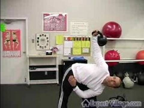 How to Exercise with a Russian Kettlebell : Kettlebell Training with Side Press Exercises - YouTube