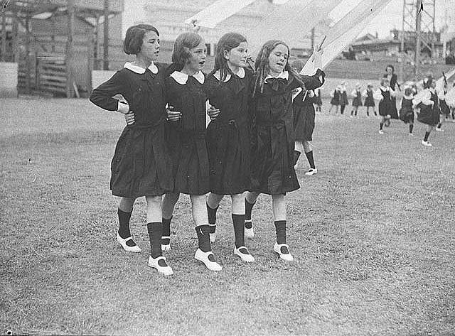 Group of four young schoolgirls singing as they dance round the maypole , 1935 / Sam Hood by State Library of New South Wales collection, via Flickr