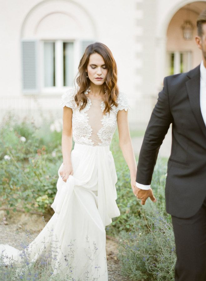 Lace cap sleeve wedding dress with a plunging sheer neckline: http://www.stylemepretty.com/2016/04/14/florence-wedding-inspiration-for-a-destination-i-do/ | Photography: KT Merry - http://www.ktmerry.com/
