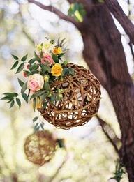 Bush wedding. Hang rattan balls with a sprig of wild flowers.