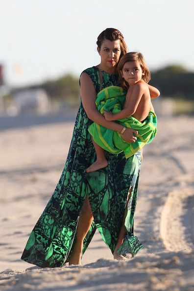 Kourtney Kardashian spends some quality time on the beach with her boyfriend, Scott Disck, and the couples son, Mason, while in Miami.