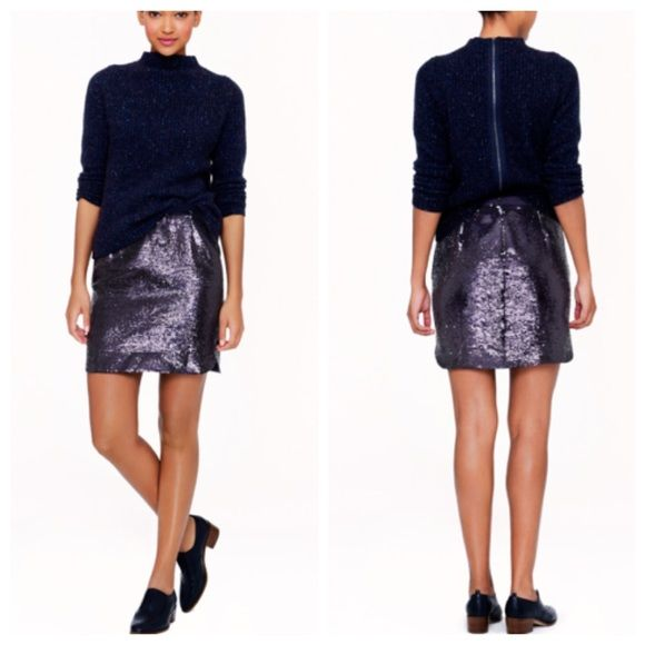 J. Crew - Shirttail Sequin Mini Skirt BNWT! Perfect skirt for every holiday soirée including New Years Eve! Color is indigo, an inky navy and looks so chic paired with black. This skirt is no longer available in stores, so don't miss out! J. Crew Skirts Mini