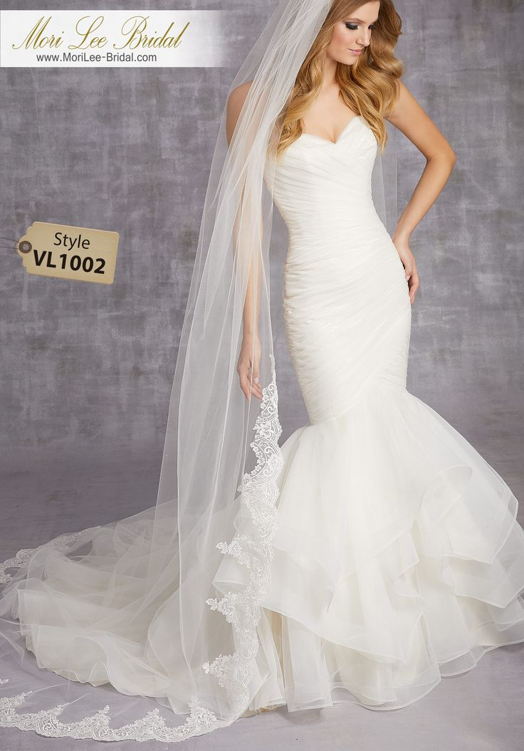 Style VL1002Scalloped Lace Veil Beaded With Clear SequinsAvailable in Fingertip Length (VL1002F), or Cathedral Length (VL1002C) Shown. Colors: White, Ivory.