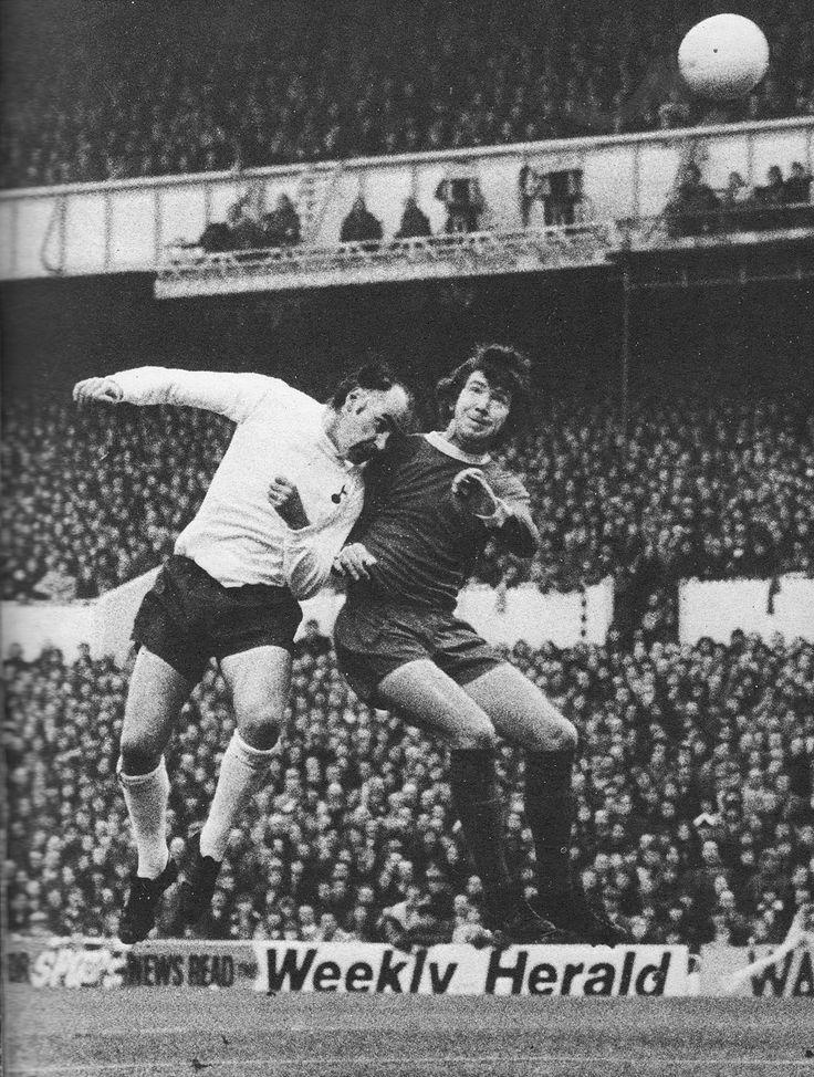 25th November 1972. Tottenham Hotspur striker Alan Gilzean tussling aerially with Liverpool full back Chris Lawler, at White Hart Lane.