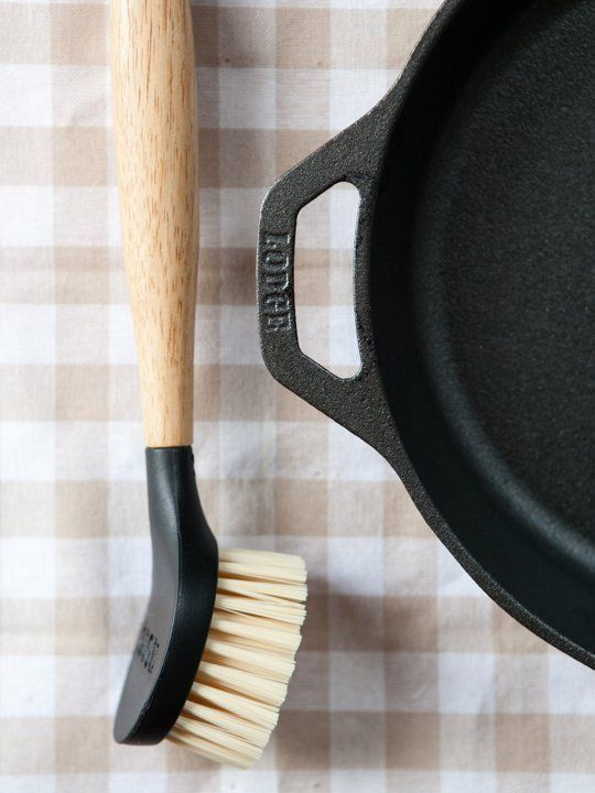 The great debate of how to properly clean cast iron cookware continues to span generations. Should you use a bristled brush or a sponge? Or simply wipe it clean with a paper towel? Soap or not, the right method and tools can help keep your hard-earned seasoning intact.