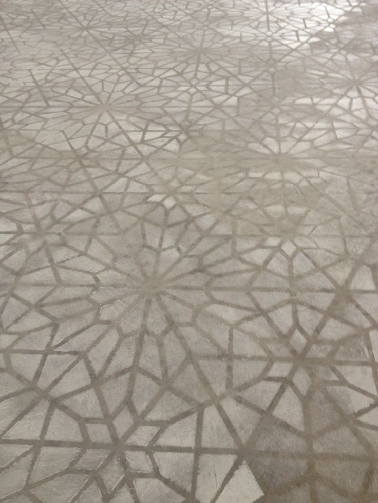 Concrete stenciled floor by Caroline Lizarraga Decorative Artist using Starry Moroccan Night Stencil from Royal Design Studio wall stencils and floor stencils and furniture stencils - photography by Catherine Nguyen Photography