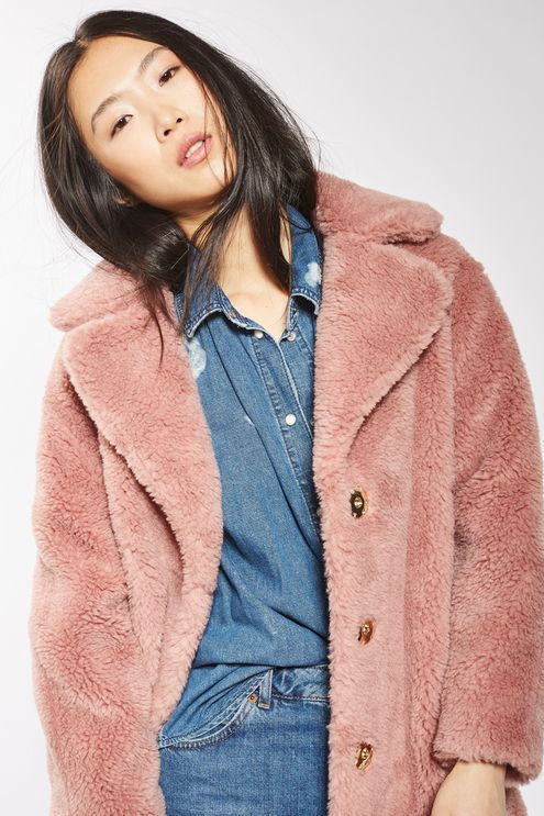 Keep your outerwear luxe with this dusky pink teddy-style faux fur coat. In an oversized style, this warm coat comes with a statement collar and popper fastening. A cold-weather must-have.