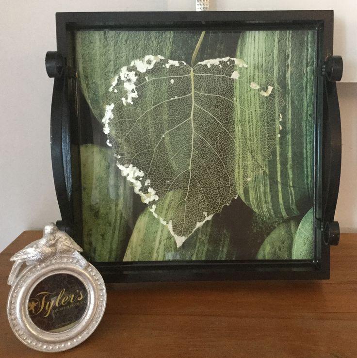 Skeletal leaf with silver leaf on tray