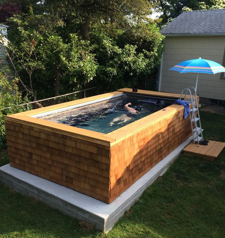 Thanks to some outside-the-box thinking, this Original Endless Pool® is skirted in cedar shake. The shingles add more than just a warm, rustic feel; they're also durable, moisture- and insect-resistant, and naturally insulating to control water-heating costs. The below-deck security cover, once closed, will also contain heat and prevent evaporation.