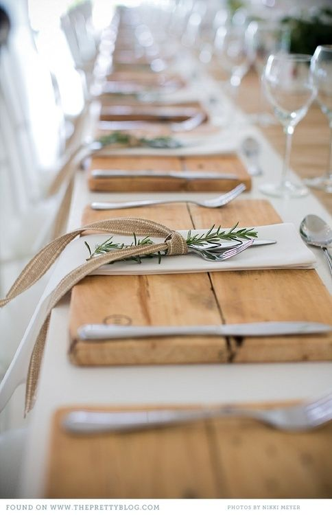 "Rustic and elegant - rosemary sprig and ribbon tied flatware on wooden cutting board ""placemats"""