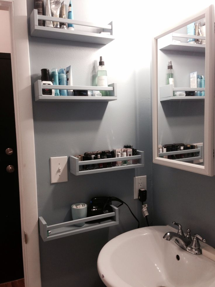 Ikea Bekvam spice racks as bathroom storage.