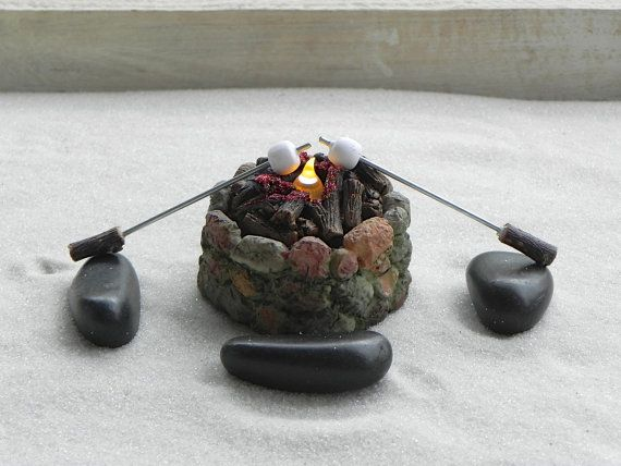 Nothing says fairy garden fun like a fire pit! They will absolutely LOVE this one with a wonderful little flickering flame, 4 stone benches and