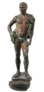 """An Ancient Bronze Statue - Greco-Roman Bronze Figure of Standing Champion Athlete, 3rd c BC, 29"""" tall, 10"""" wide, set onto wooden plinth."""