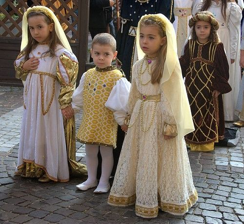 """The caption read """"Medieval Children"""" but the boy in the middle knows their true evilness level....I love his face, his mouth shows unhappiness, but his eyes are planning revenge!"""