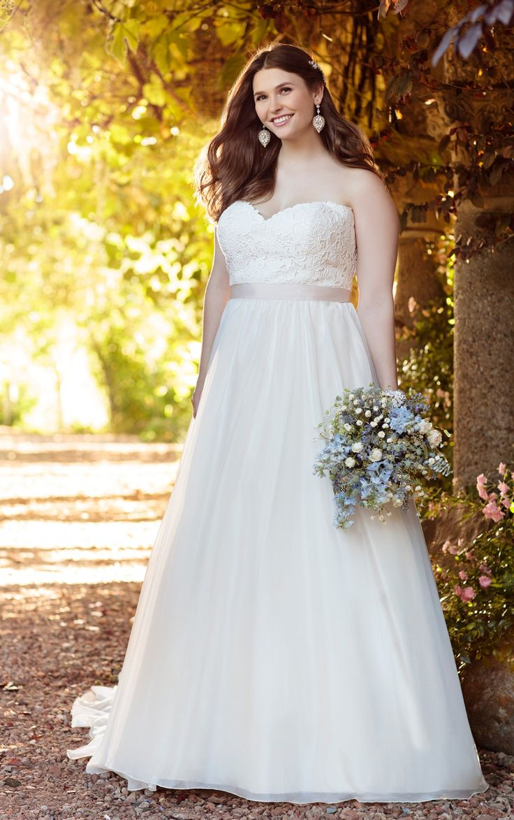 Essense of Australia plus size ball gown wedding dress features a detachable beaded Tulle peplum to bring your wedding day a visual balance of classic and chic.