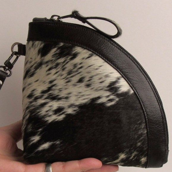 Black and white cow hair on hide wristlet / clutch
