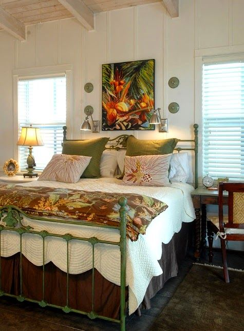Tropical bedroom. Green and white with pops of orange and yellow: http://www.completely-coastal.com/2015/01/coastal-nautical-tropical-home-decor-house-tour.html