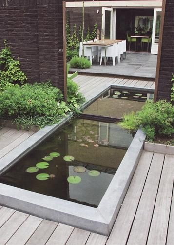 If this was a small yard, you could use a mirror to make this illusion of a long water feature