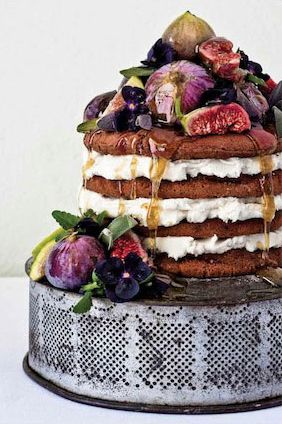 wedding cake idea...cheesecake on the bottom and hugacious chocolate chip cookies with a yummy filling.. cream cheese maybe??  drizzled with caramel, and love the purple fruit and flowers!
