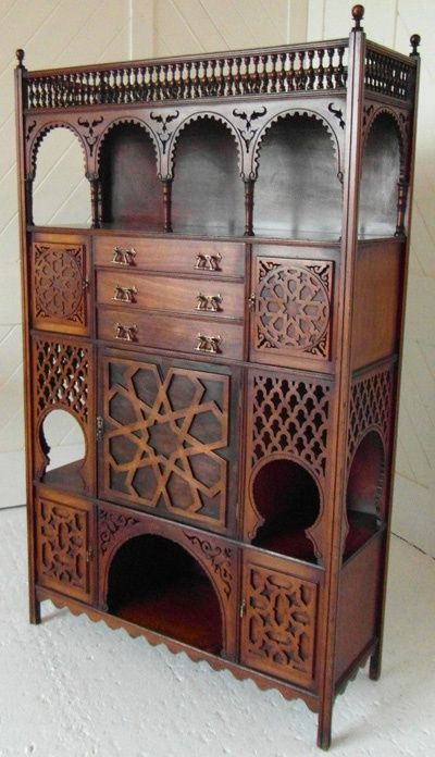 LX_14 Aesthetic Movement walnut cabinet Aesthetic Movement Moresque style walnut cabinet with turned spindle decoration and arching galleries. Decorative arabic fretwork panelling, 5 cupboards and 3 drawers with decorative brass fittings. Retailed by Liberty & Co Circa 1880