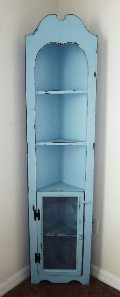 Corner hutch, needs a glass door on each level to keep out the cat!