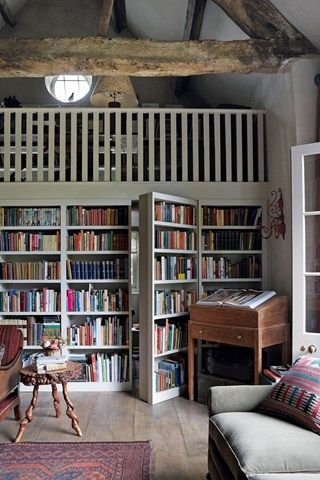 In the sitting room, shelving opens to reveal a secret bathroom and floor- length Anatolian curtains provide warmth in winter