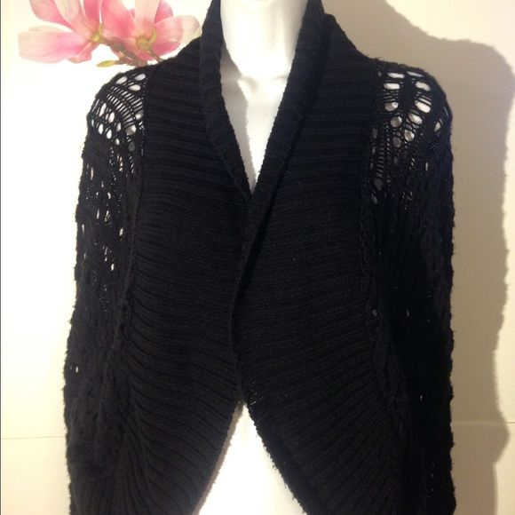 Venezia Ladies Black knitted Cardigan This is a Venezia brand black knitted style ladies cardigan. It is a size 18/20 made from 100% acrylic. It has a folded collar and no buttons, no zippers, no fasteners. Venezia Tops