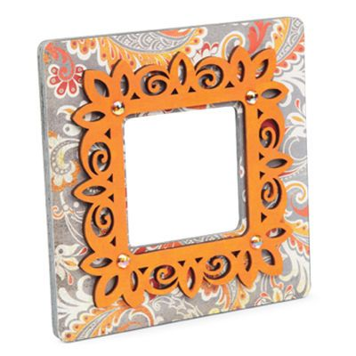 cool use of the unfinished laser cut frames from michaels adding on top of a