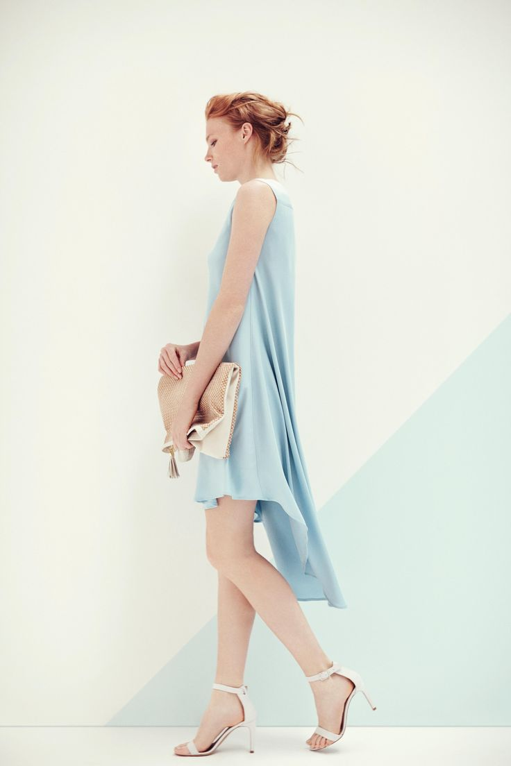 Asymmetric dress in silk stretch twill with AMF stitching details on neck. Pochette in raffia and leather. TONELLO WOMAN SS15 www.tonello.it
